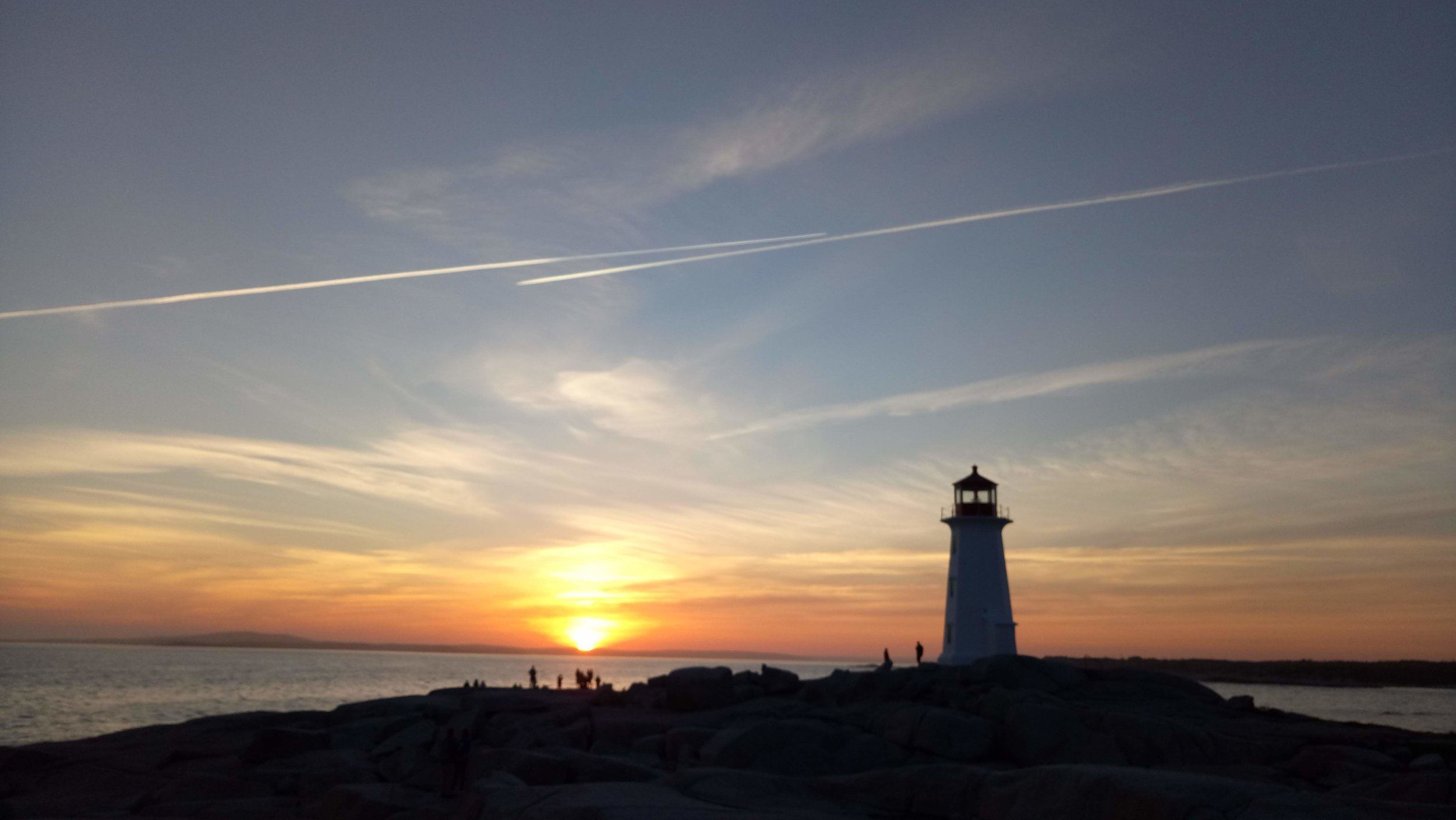 I highly recommend visiting Peggy's Cove to watch the sunset.