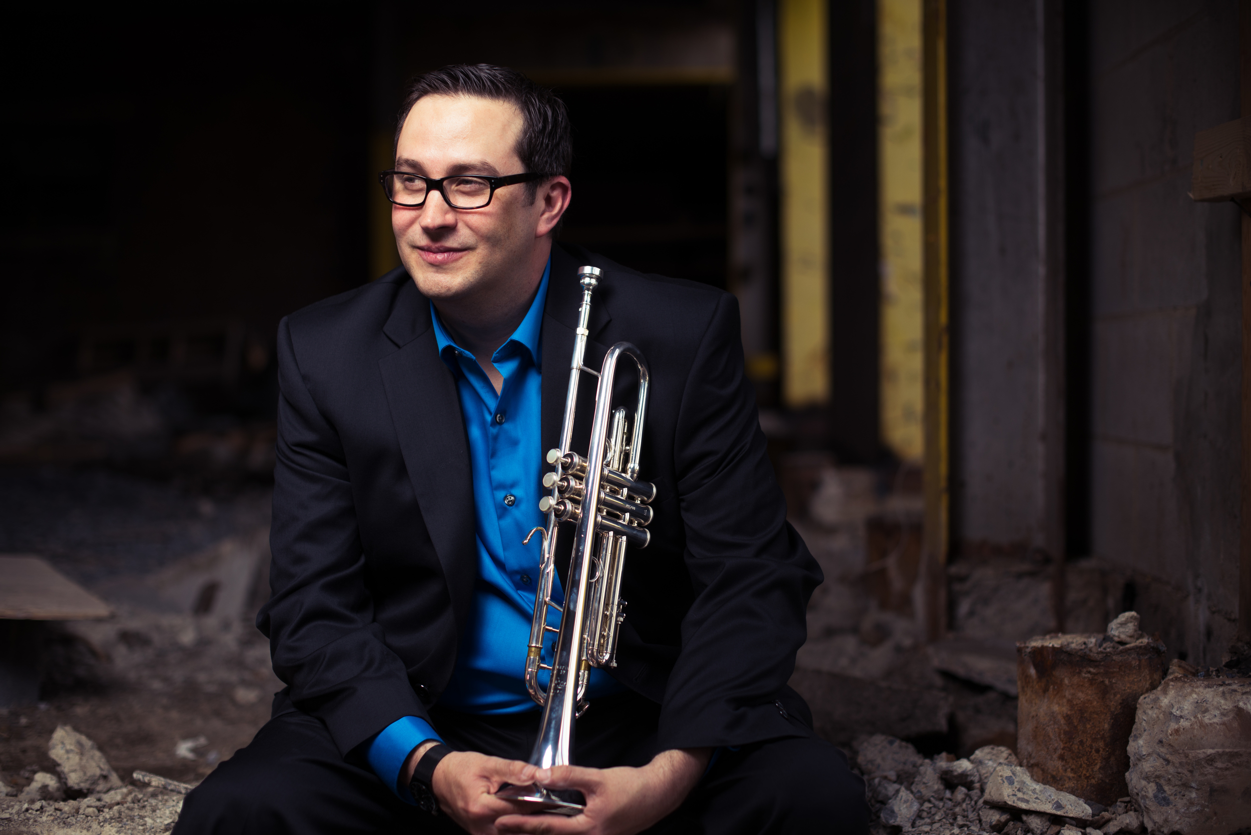 Chris Carrillo , trumpet  Chris Carrillo joined the  faculty of James Madison University  in 2009 as the studio trumpet professor in the College of Visual and Performing Arts. He currently performs with the Madison Brass and the  New Orchestra of Washington . Solo engagements and chamber collaborations have taken him throughout the United States, Australia, Germany, and the United Kingdom performing in some of the world's finest concert halls including Carnegie Hall in New York City, the Kennedy Center for the Performing Arts in Washington, D.C., and City Recital Hall in Sydney, Australia.