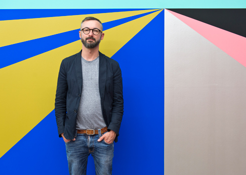 Lothar Götz in front of his work 'Double–Take' at the MAC, Belfast, in 2013, photo by Jordan Hutchins