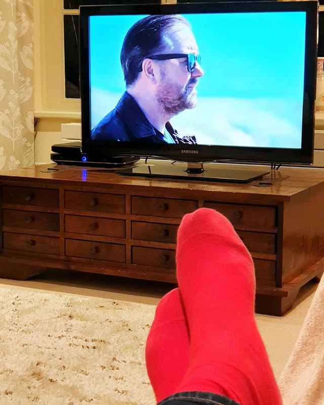 #Winddowntime. Long day in London, but now home feet up watching #rickygervais #afterlife on #netflix with a nice glass of red. He's a bit of #teĺly genius is Ricky, he manages to catch the mood with comedy and pathos just right, with brilliant casting roles to match. Great stuff.  #relaxing #redsocks #chilling #goodtelly #lifestylephotography #lifestyleguide #sockman #nightin