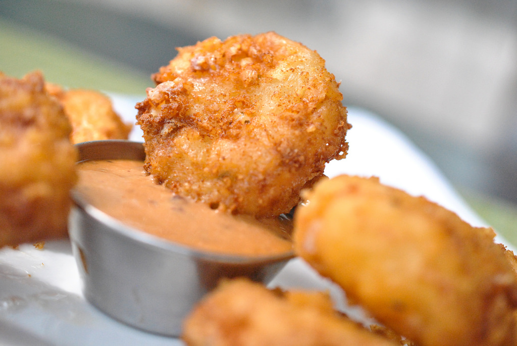 Homemade Tater Tots - It's a rare occasion when we come across someone who doesn't like tater tots. They're fantastic finger food, all crunchy on the outside and warm and mushy on the inside. Sure, there's a good chance there'll be a lot more spuds (mashed potatoes or yams anyone?) at the Thanksgiving table, but it's basically a national diet cheat day so hakuna matata. Besides, a few tots won't load you up too badly.