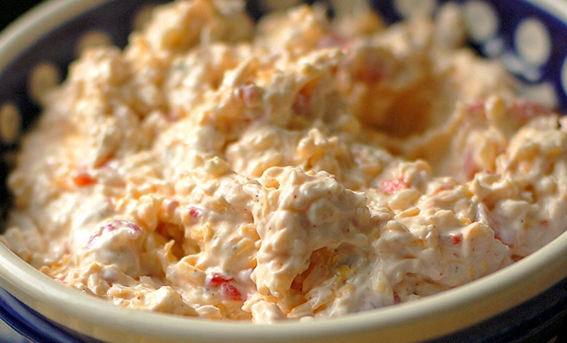 Bacon Pimento Cheese Dip - Ooooh pimento cheese dip, how do we love you? Let us count the ways. And then the added bonus of bacon!? Who needs Thanksgiving dinner!? Just give us a bowl of this stuff and the remote control and we are happy campers. Seriously. This stuff is beyond delicious. Pro Tip: Ok. We know what we just said. We were being serious but also hyperbolic. Despite what we just said, someone worked super hard on your Thanksgiving dinner—likely for hours—so don't fill up on this too too much. Leave some room for that beautiful turkey and all the yummy sides. Just saying.