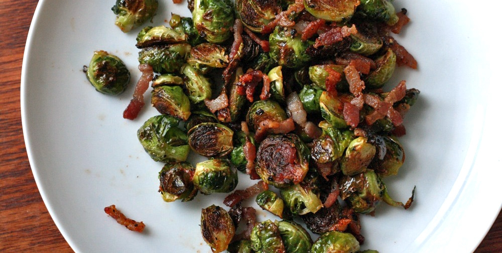 Mean Green Brussel Sprouts - Brussel sprouts have grown in popularity in the last 5-10 years in such a way as to blow the mind. We remember when they were the most disgusting vegetable—if not food— basically on Earth when we were kids. Now they're on every menu, mostly likely including your Thanksgiving Day menu. Here's a tasty spin on it, bacon optional. (For us, however, bacon is never an option. It's a necessity).