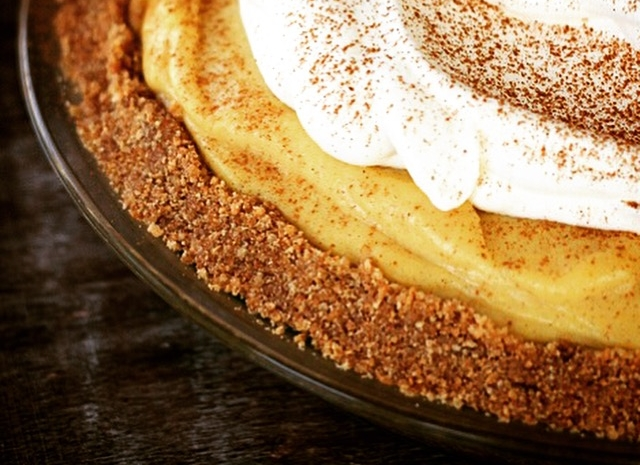 "Pumpkin Spice Pie - Okay okay okay. So we just talked smack about pumpkin pie and now we're presenting you with a recipe for one? Yeah. We know. But some folks are traditionalists and love their pumpkin pie. And we happened to have this recipe in the desserts (""Sweet Endings"") section our our website so…Here's why we like this recipe over store-bought pumpkin pie: it's really creamy, it's got a kick (we make our crust with ginger snaps!), and the flavors in the pumpkin part are pretty amazing because we use our own pumpkin spice blend (which rocks if we don't say so ourselves). Top the pie with some whipped cream (and a sprinkling of cinnamon or nutmeg) and this takes pumpkin pie to a place you didn't know it could go. And it cooks in just 35 minutes! (We usually prep it the day before and then bake it during dinner clean-up to give everyone an eating break)."