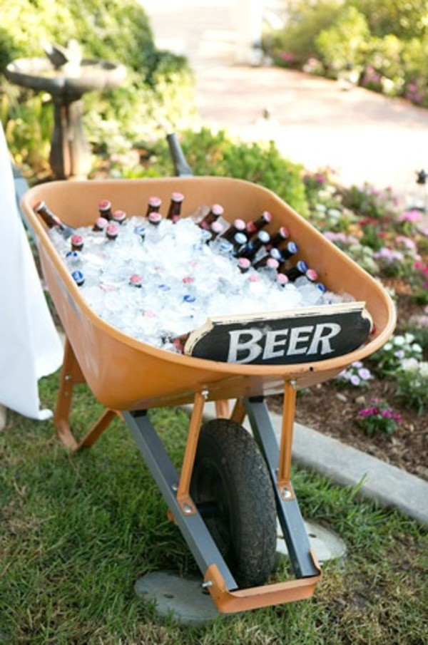 "The Beer Wheelbarrow - It's a DIY-kind-of-trick and we love it. Grab that wheelbarrow gathering rust in the garage, fill it with ice and plenty of beer and you've got yourself a cool take on the beer bucket! Plus, you didn't have to go out and buy a new bucket. It's as the old saying goes, ""Waste not. Want not."""