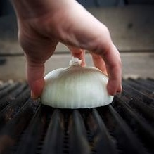 Onion Grill Hack - This grilling hack is super useful and even more simple.What to Do: Cut an onion in half and rub the onion all over your heated grill, cut side down.This will make the grill non-stick! Then you'll be all set to grill and feed your own hungry fans!