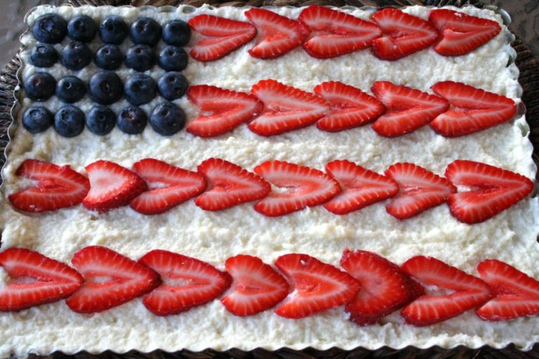 Old Glory Pie - Here's a super easy and fun American-themed dessert: We call it Old Glory Pie! It's a fruit and mascarpone tart and it's delicious. All it is is a graham cracker crust (you can make on your own or buy store-bought—and the normal round shape works too). Top with mascarpone cheese (add sugar as desired) and strawberries and blueberries. Super simple!