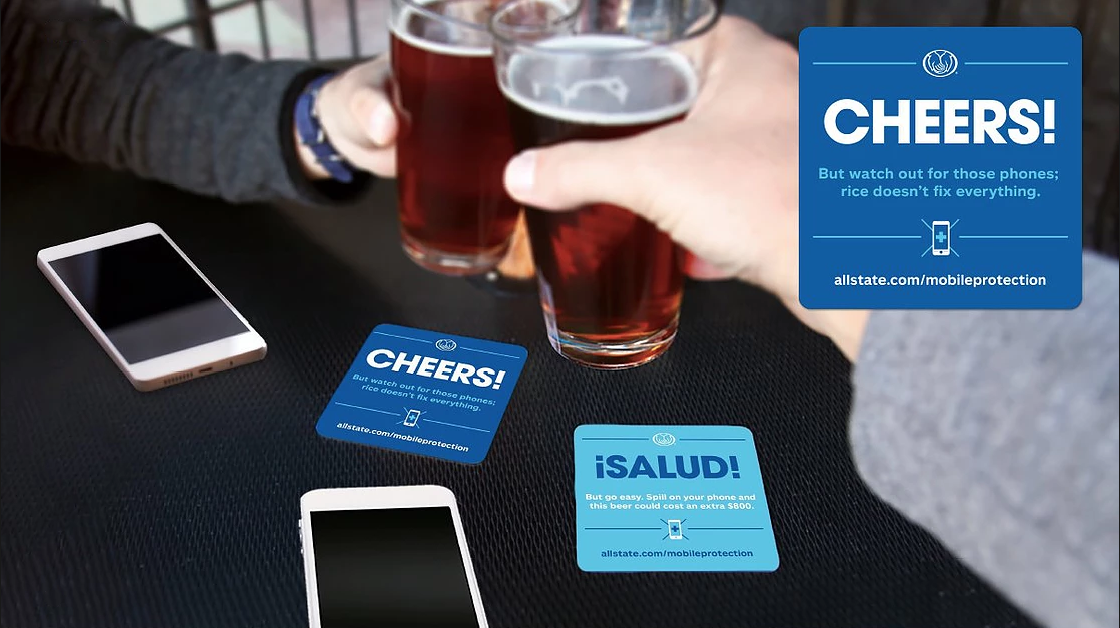 """""""Cheers! But watch out for those phones; rice doesn't fix everything."""" """"¡Salud! But go easy. Spill on your phone and this beer could cost an extra $800."""""""