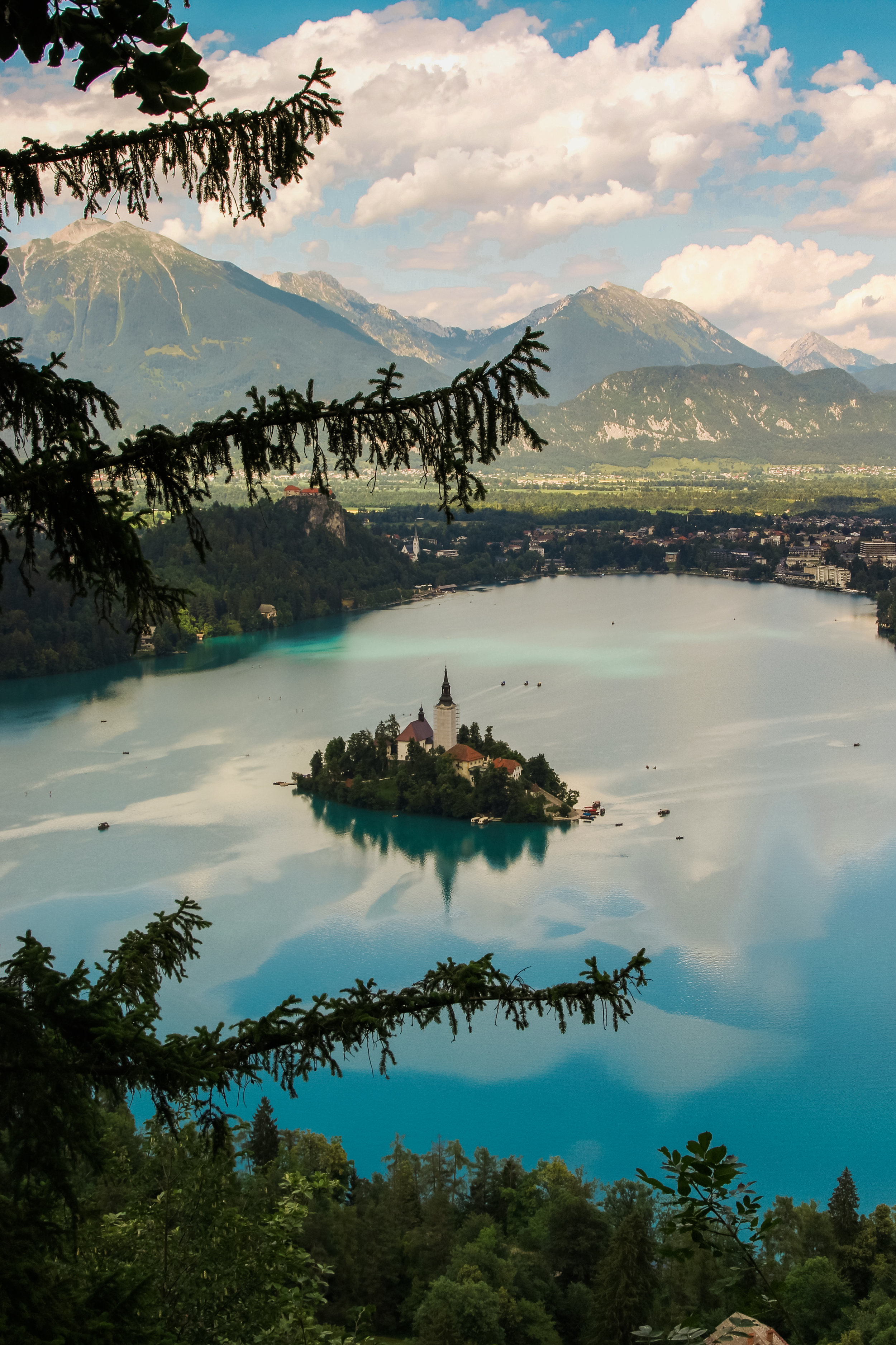 """- My next task was to find the famed viewpoints and get one of the shots of Lake Bled that I'd been dreaming of. I was forewarned that they were steep and challenging, and I went for the """"worst"""" one – Mala Osojnica. The other, Ostrica, is less strenuous. If you have time, it appears that both are worthwhile and offer their own unique view of the lake. It has also come to my attention that there are signs directing you to both. I followed my Google maps like an idiot and ended up stumbling through someone's backyard until I came across a path that ultimately led to Mala Osojnica. Not a single sign was seen. I've only confirmed that I made it to the right place by Googling other people's photos and finding that we all climbed the same ridiculous staircase at the end. But the good news is you'll get up there one way or the other."""