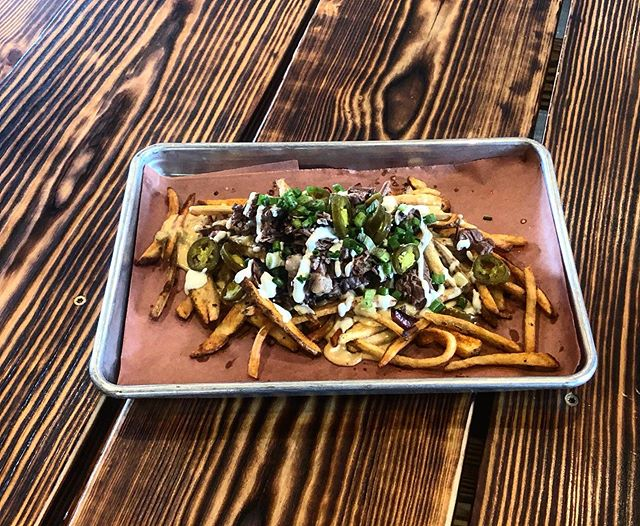 Testing out something new tonight. Grab a seat and check out our atomic fries!  Twice cooked fries tossed in bbq rub, scratch made queso sauce, your choice of meat, topped with green onion, jalapeños and a lime crema. $10