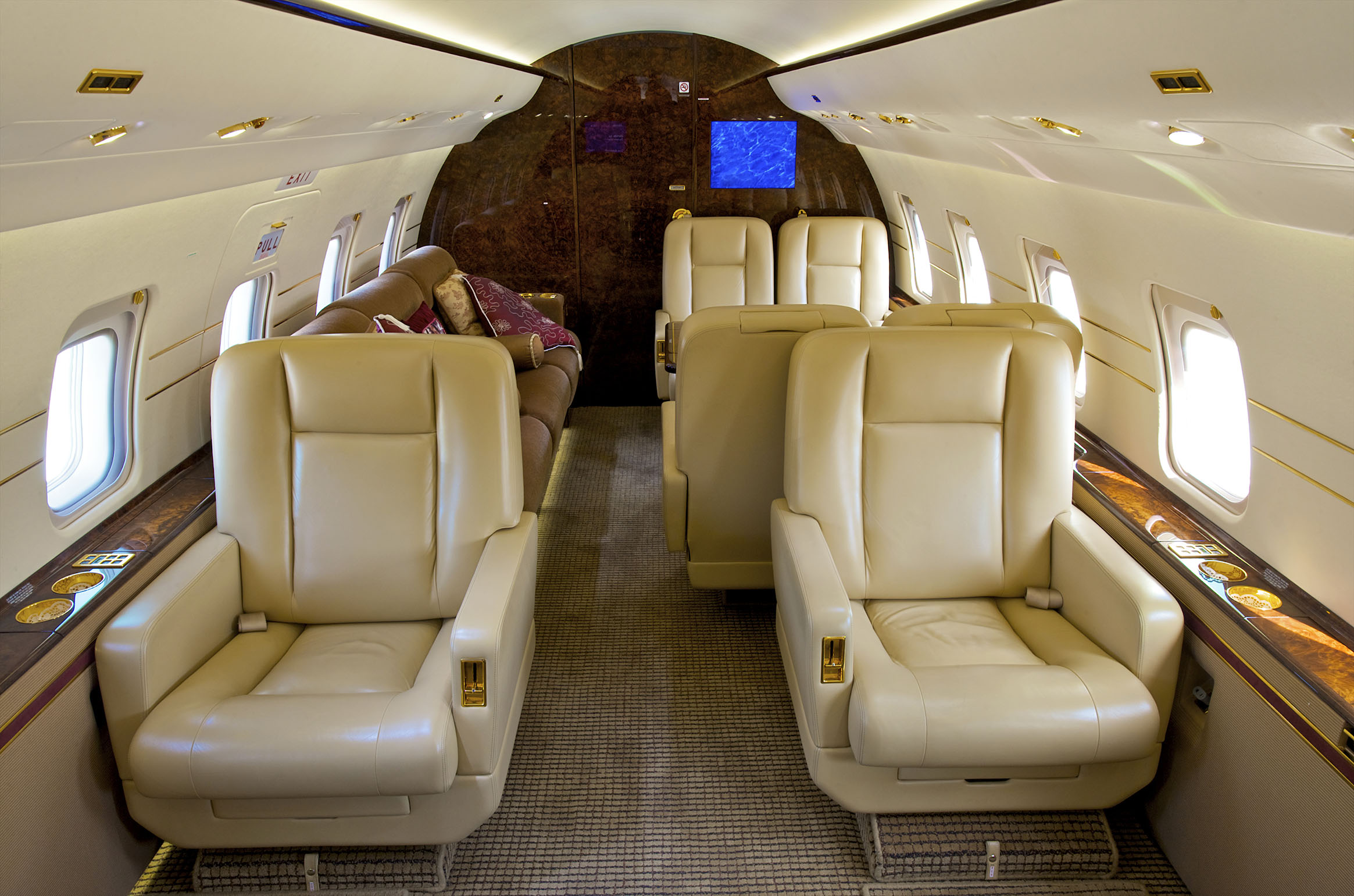 "Interior of a Bombardier Challenger 600 series jet. Extra wide cabins come standard on ""heavy jets"", affording high levels of comfort for long-distance flights. Above banner: Dassault Falcon 2000."