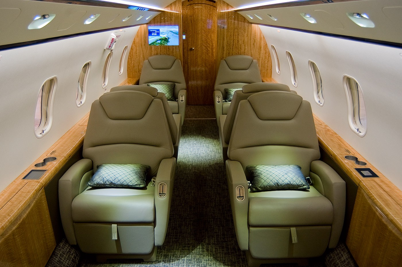 Interior of a Bombardier Challenger 300. Above banner: Bombardier Challenger 300.