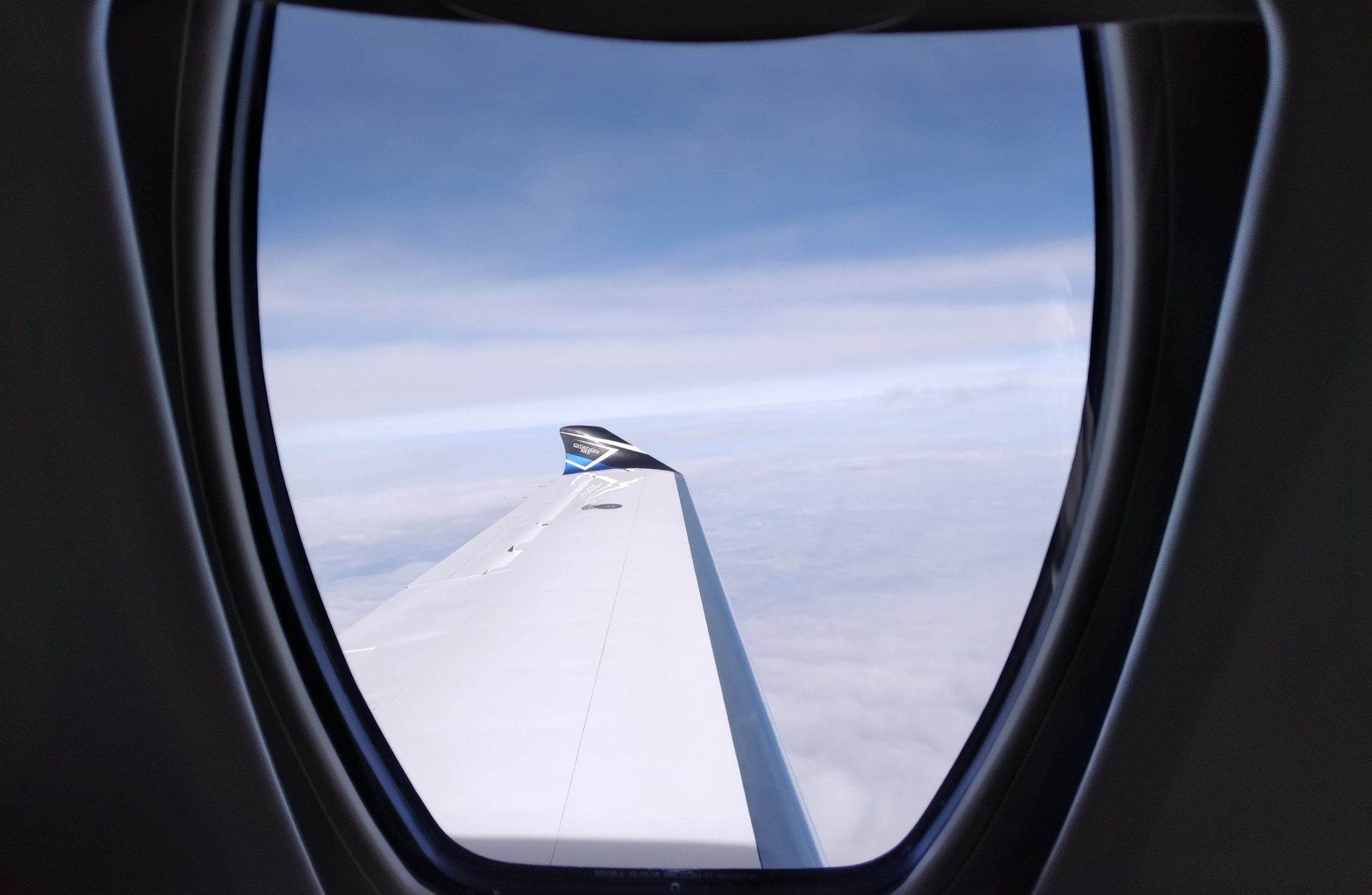 Looking out the uniquely-shaped Citation M2 window as we cruise comfortably above most commercial air traffic.