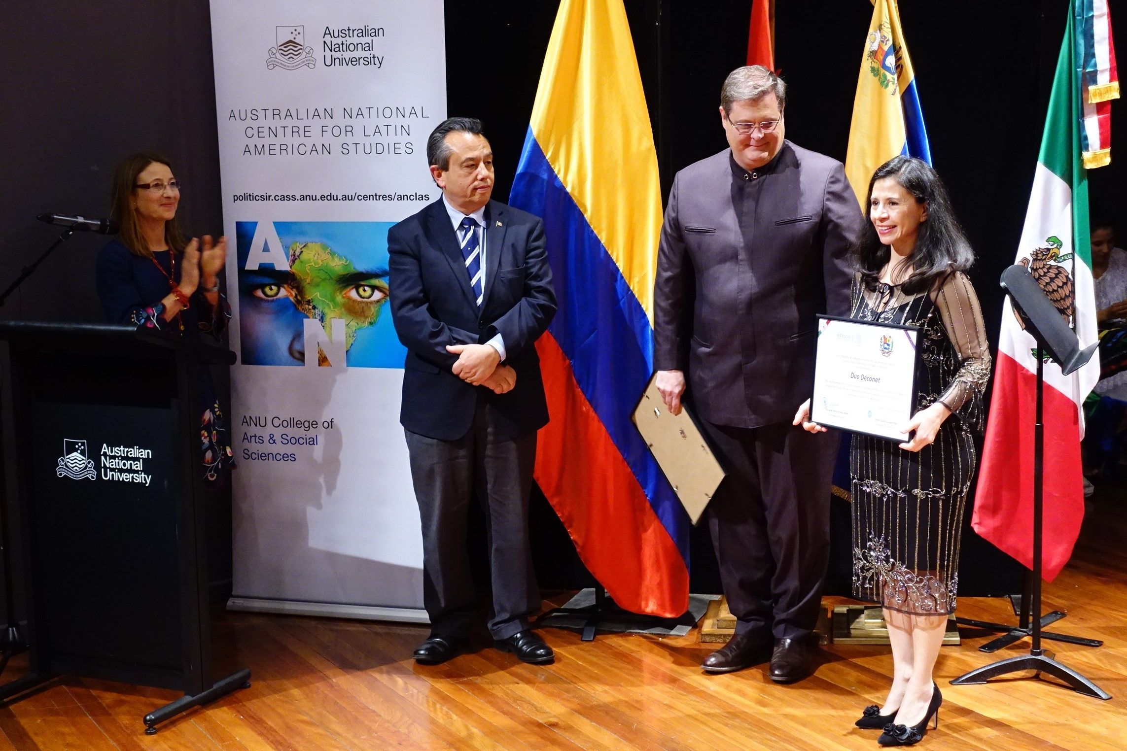- Irma receiving an honorable award for her outstanding musical career and her contribution to promote Latin American cultural heritage in Australia