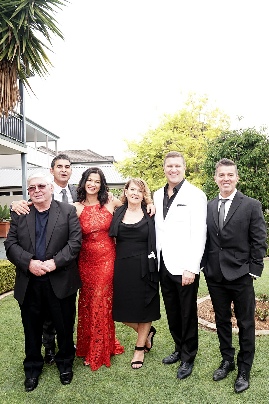 Marcella with mum, dad, brothers and husband Craig. Photo by Andrew Gito.