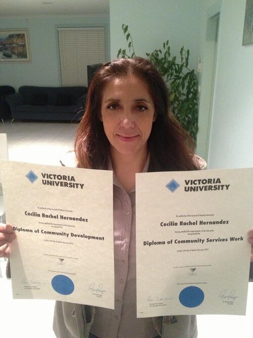 Cecilia holding her double degrees