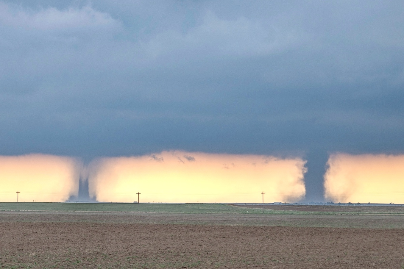 Two tornadoes at the same time - Is it possible? Yes, it is. On 29 May 2018 we intercepted these two in eastern Colorado. The right one is the main supercell tornado. The left one is located on the RFD and could be either cyclonic or anti-cyclonic. In all our years of chasing, we have seen this several times.