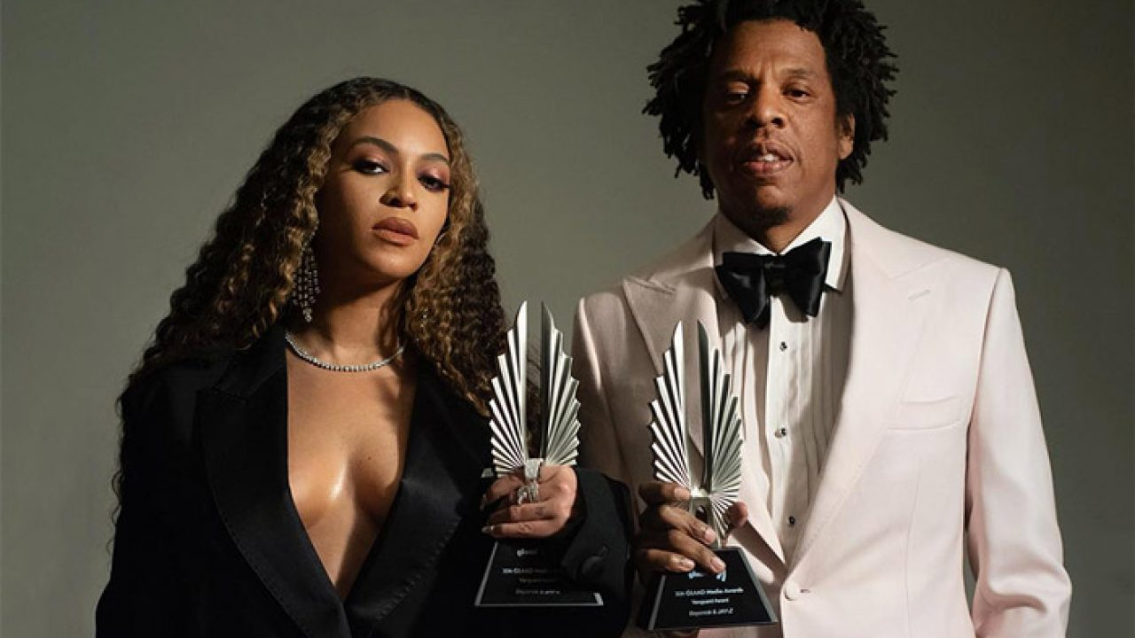 Beyoncé and Jay-Z Holding Their GLAAD Vanguard Awards