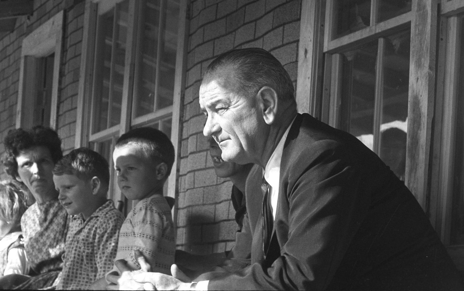 (President Lyndon B. Johnson visit to Tom Fletcher residence during Poverty Tour of Appalachia. Serial Number: 215-21-WH64. Date: 04/24/1964. Credit: LBJ Library photo by Cecil Stoughton.)
