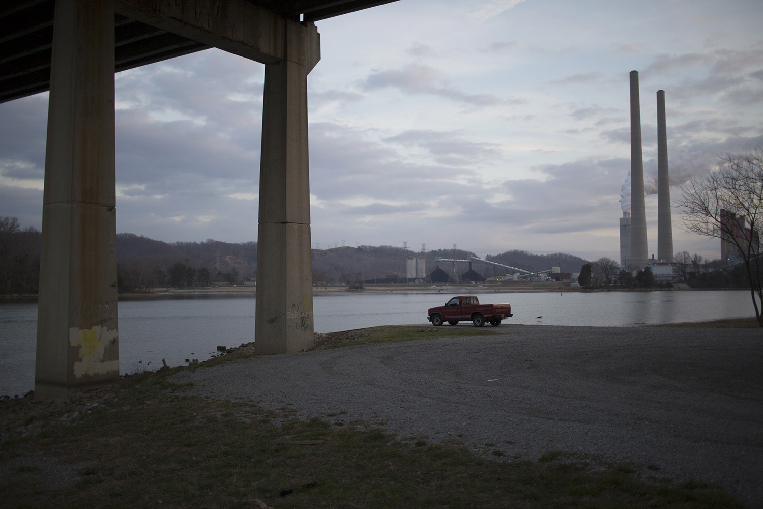 Nathan Armes . March 15, 2014. Kingston, Roane County, Tennessee. My grandfather's truck sits under I-40 where the highway crosses the Clinch River in Roane County. The smokestacks of the Kingston Fossil Plant, managed by the Tennessee Valley Authority in Kingston, have dominated the small town's skyline since the 1950s. The plant burns about 14,000 tons of coal a day.