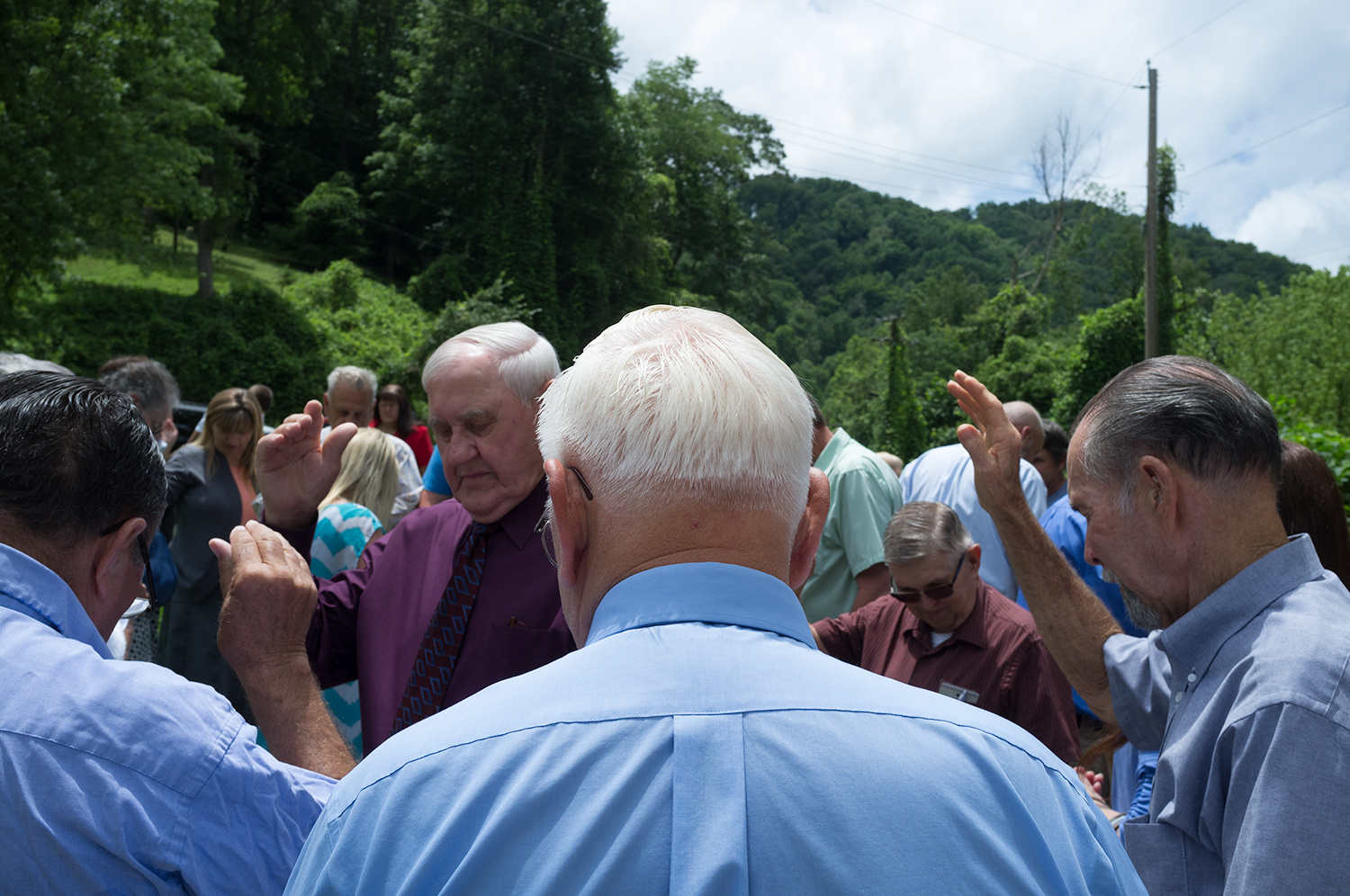 Roger May . July 5, 2015. Members of the Dix Fork Old Regular Baptist Church pray after baptizing Ruth Vanhoose, 84, of Chattaroy, West Virginia. She was baptized in Big Creek, Pike County, Kentucky, where members have been baptized for decades.
