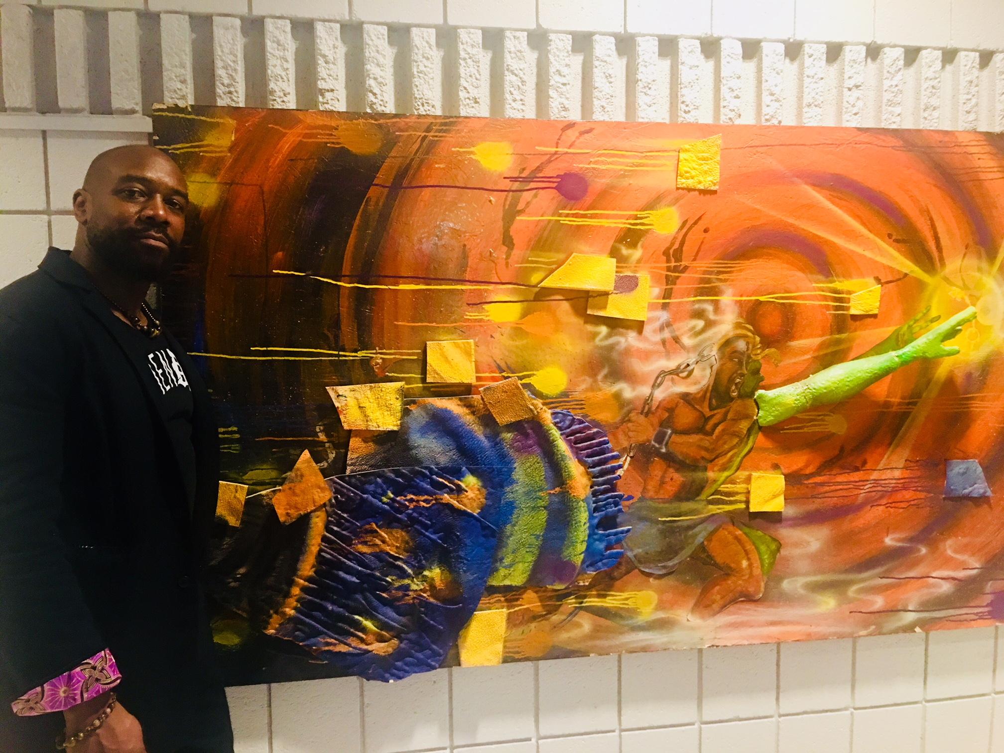 "Artist Nivek Monet with his multi-media canvas ""Transcendence"""