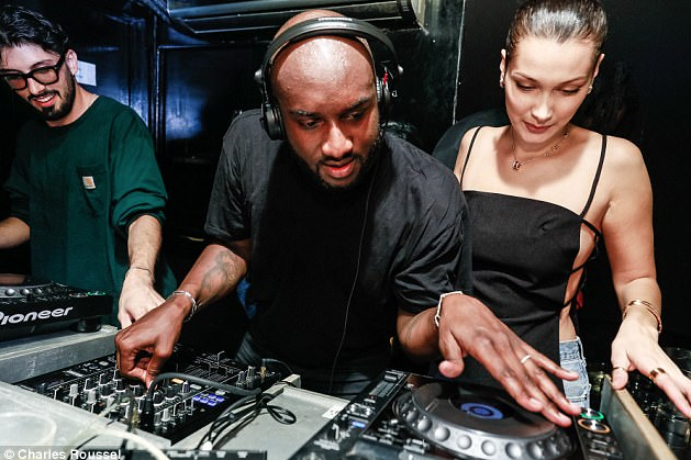 """With creativity and talent beyond his fashion design empire, Virgil Abloh is also a skilled DJ (here with supermodel Bella Hadid @ NYFW for """"The Birds Eye View"""" set). Image courtesy of  garmdrop.com . Look for Virgil Abloh at this year   Movement Festival in Hart Plaza Detroit May 25th, 2019."""