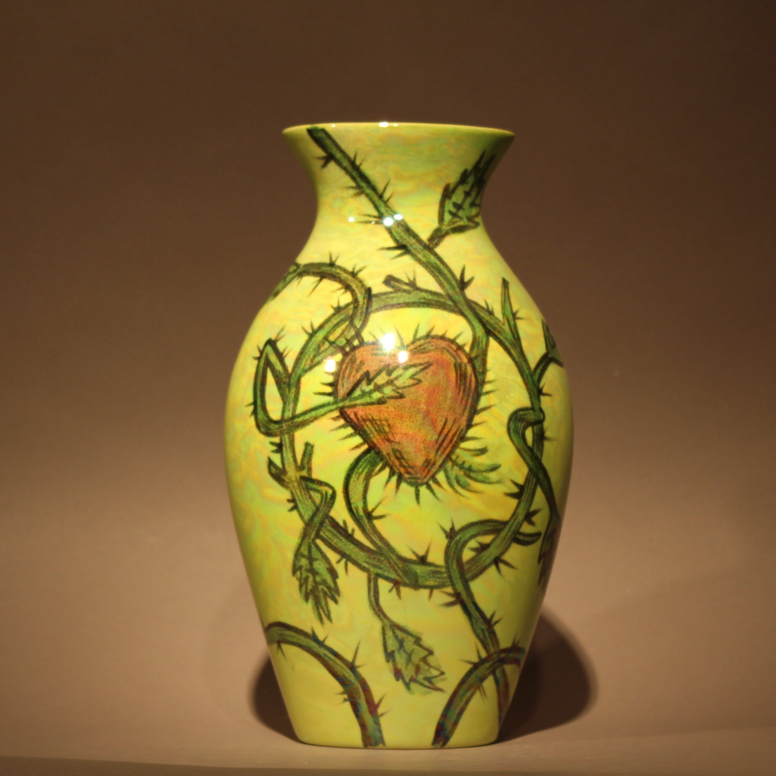 "Dimensions: 9.5"" H  Year: 2010  Medium: Luster overglaze on low fire ceramic vase  Cost:$750"