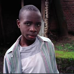 Bakunzi - (Photo by Musa) Born 1987I was born in 1987 in a medium family--not very rich, not very poor. The war started when I was 7 years old and we fled to the Congo with the whole of my family--three sisters, my mom, my dad, and me. We spent abut two months there, and after our parents' deaths we returned home alone--my sisters and I. My parents died of disease. They were not killed. When we reached home we spent a few days with our neighbors, and in December 1994 we went to the Imbabazi orphanage. In the orphanage, I started my primary school.