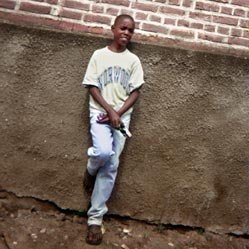 Imanizabayo - Born 1987My name is Imanizabayo. I was born in 1987 in the small town of Gisenyi. In 1994, when I was seven years old, many things changed in our country and in my life because of the war and the genocide. Both my parents passed away during that war. I fled alone to the Congo where I entered an orphanage founded by a lady called Mrs. Christine. When we were about to return to our country, the orphanage was destroyed. I was taken by the Red Cross organization which brought me to the Imbabazi Orphanage. At that time I had found my big brother, Musabyimana Sammy, who stayed together with me in the orphanage until now.