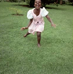 Umahoza - (Photo by Jacqueline) Born 1989Umuhoza arrived at the Imbabazi Orphanage at the age of seven in September, 1996. Her parents were never located. Although she was old enough to remember her parents she claims she does not remember them. She is one of the best dancers among the children.-- Rosamond Carr