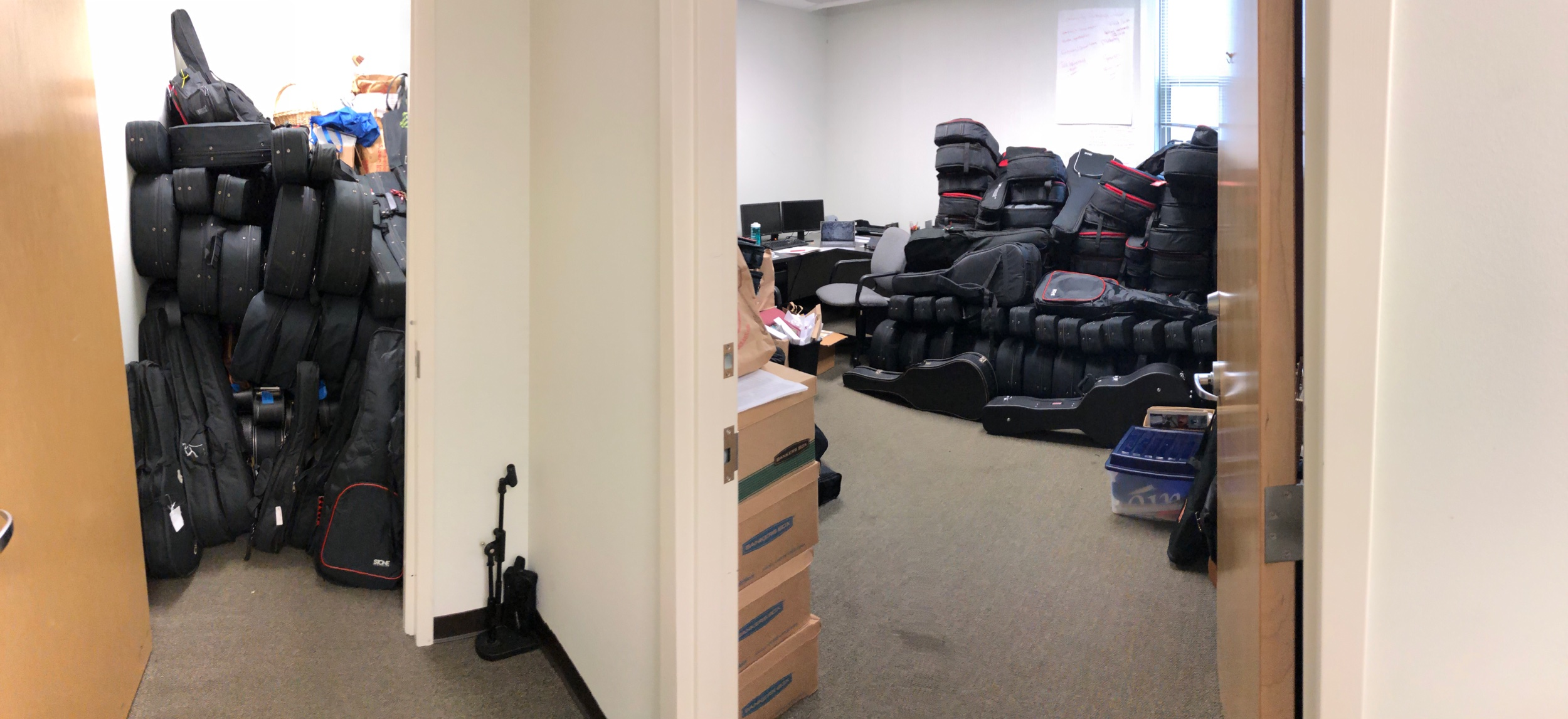 Two piles of guitars in our office at the Centene Center for the Arts