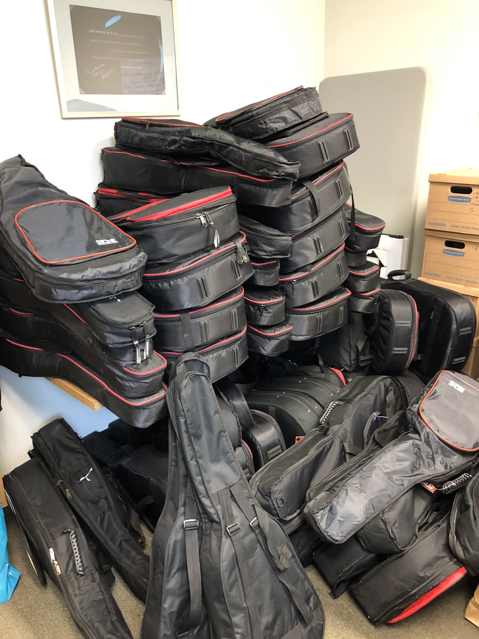 A 3rd pile of guitars in our office at the Centene Center for the Arts