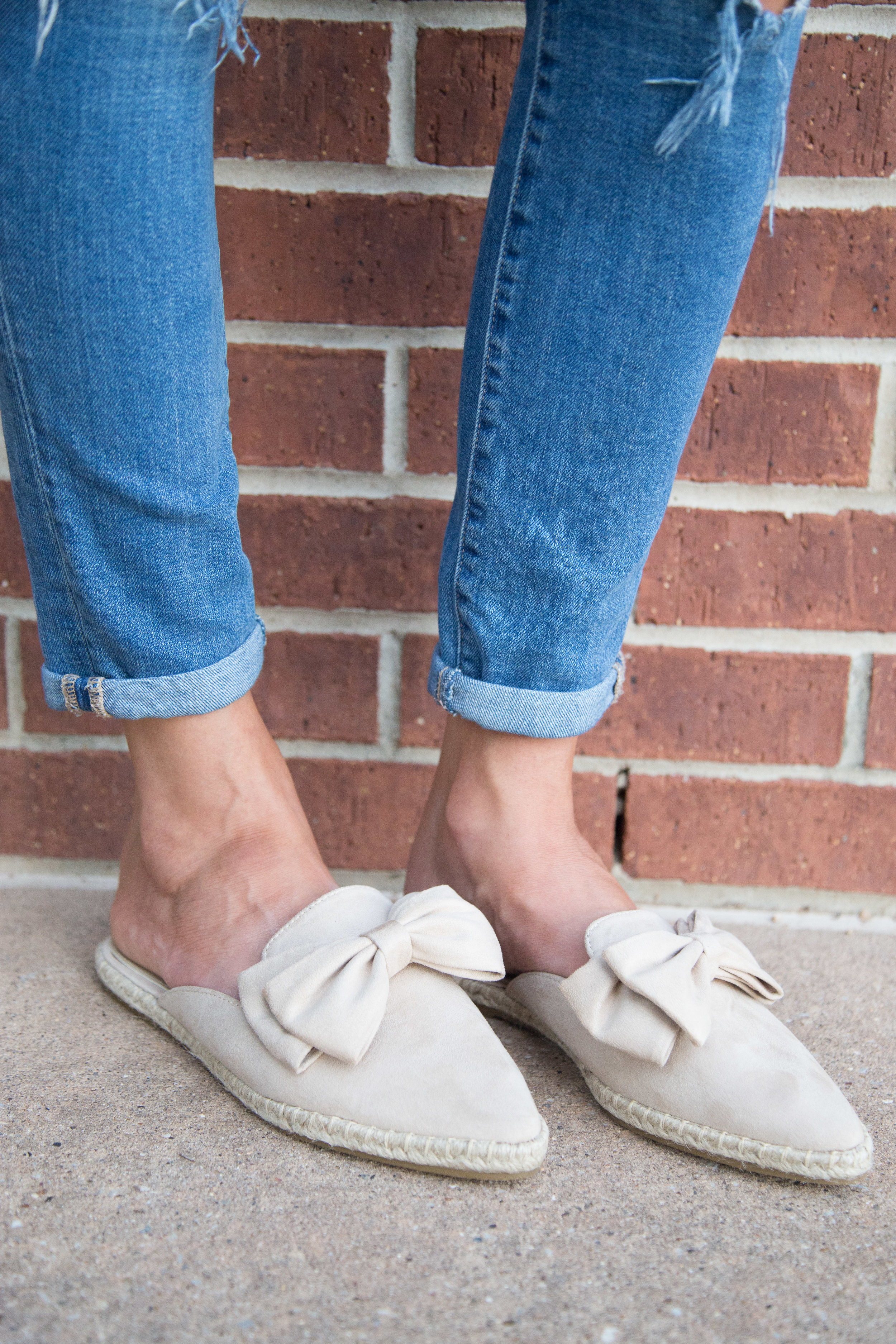 Besides the fact that you really can't go wrong with nude shoes with bows. A pair of closed toed slides can easily be worn into the fall (and then again in the spring!). I have a little bit of a gap between my foot and the shoe, so keep that in mind in determining if these are for you.  I'd say my foot circumference is average to slender.