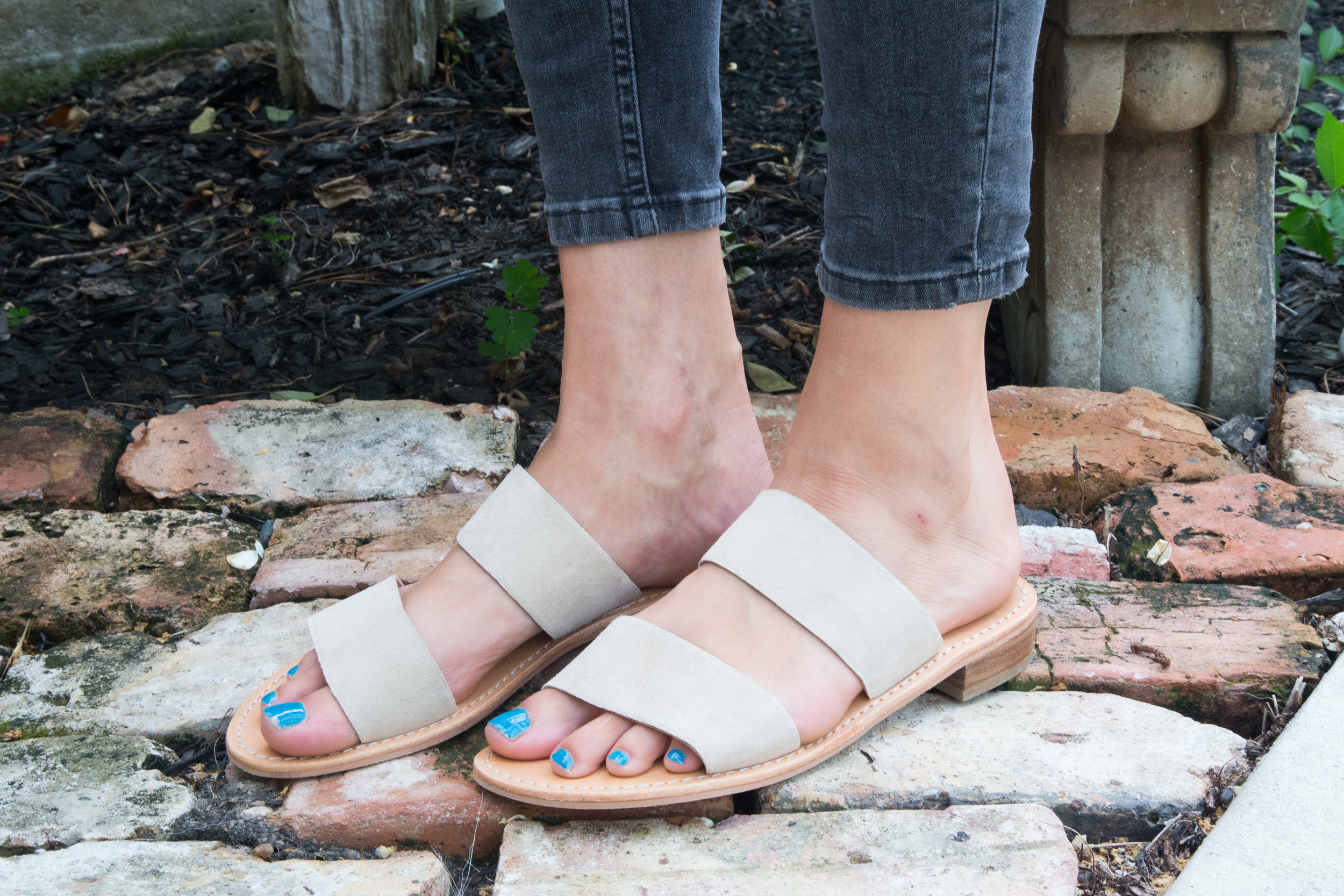 I am obsessed with these sandals. They made it into my  July Favorite's  blog post.  The souls are not padded and the straps are made of genuine leather. They are very comfortable and are perfect for dressing up or down.