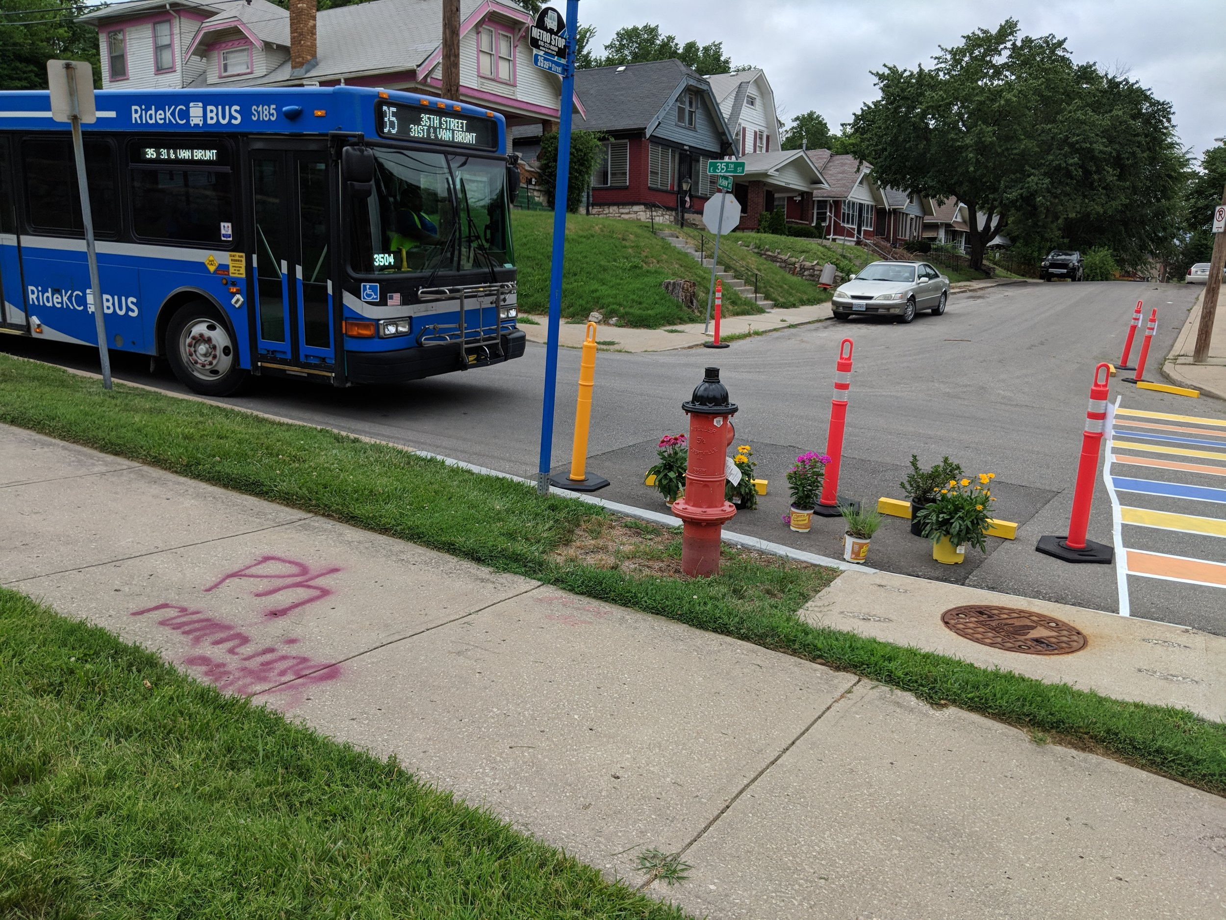 Sometimes infrastructure improvements as simple as a crosswalk can bring about big change. In the picture above you can see a temporary crosswalk and bus stop improvement my colleagues and I installed at the corner of 35th and Askew right next to the Palestine Missionary Baptist Church.