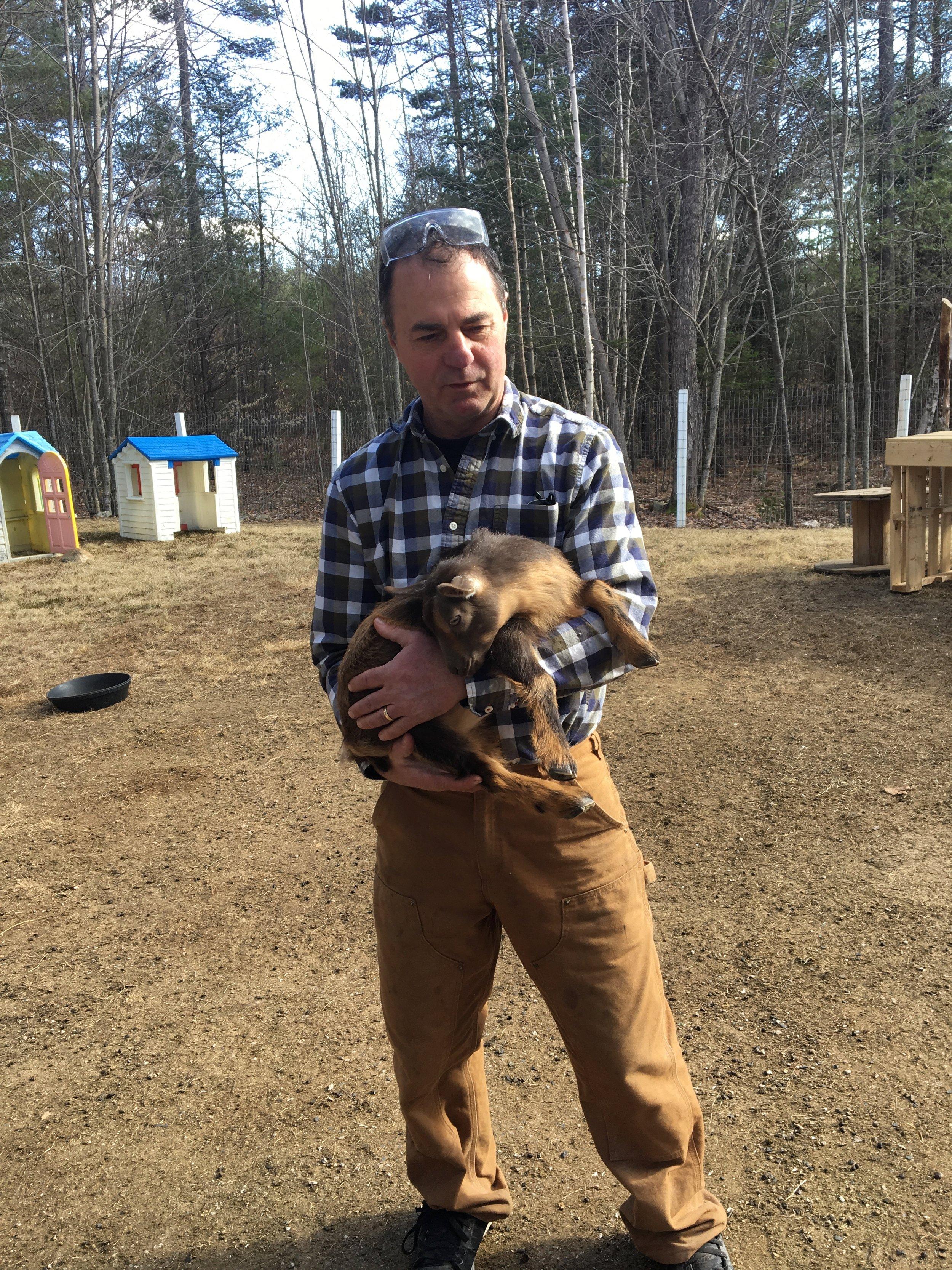 Frank holds goat at Bending Birch Farm