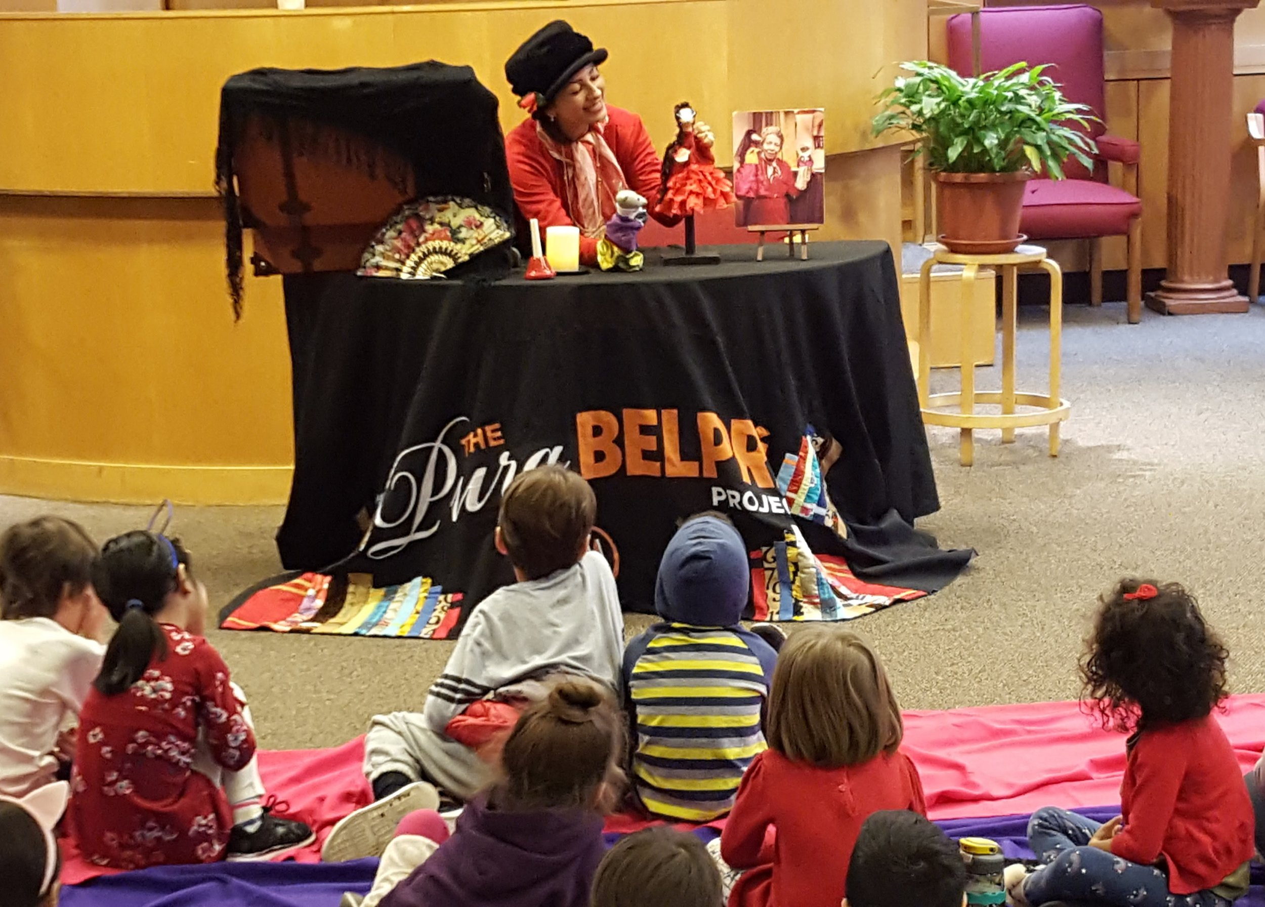 "A puppeteer from Teatro SEA presented ""The Pura Belpré Project,"" stories by the late Puerto Rican NYC librarian. December 2017."