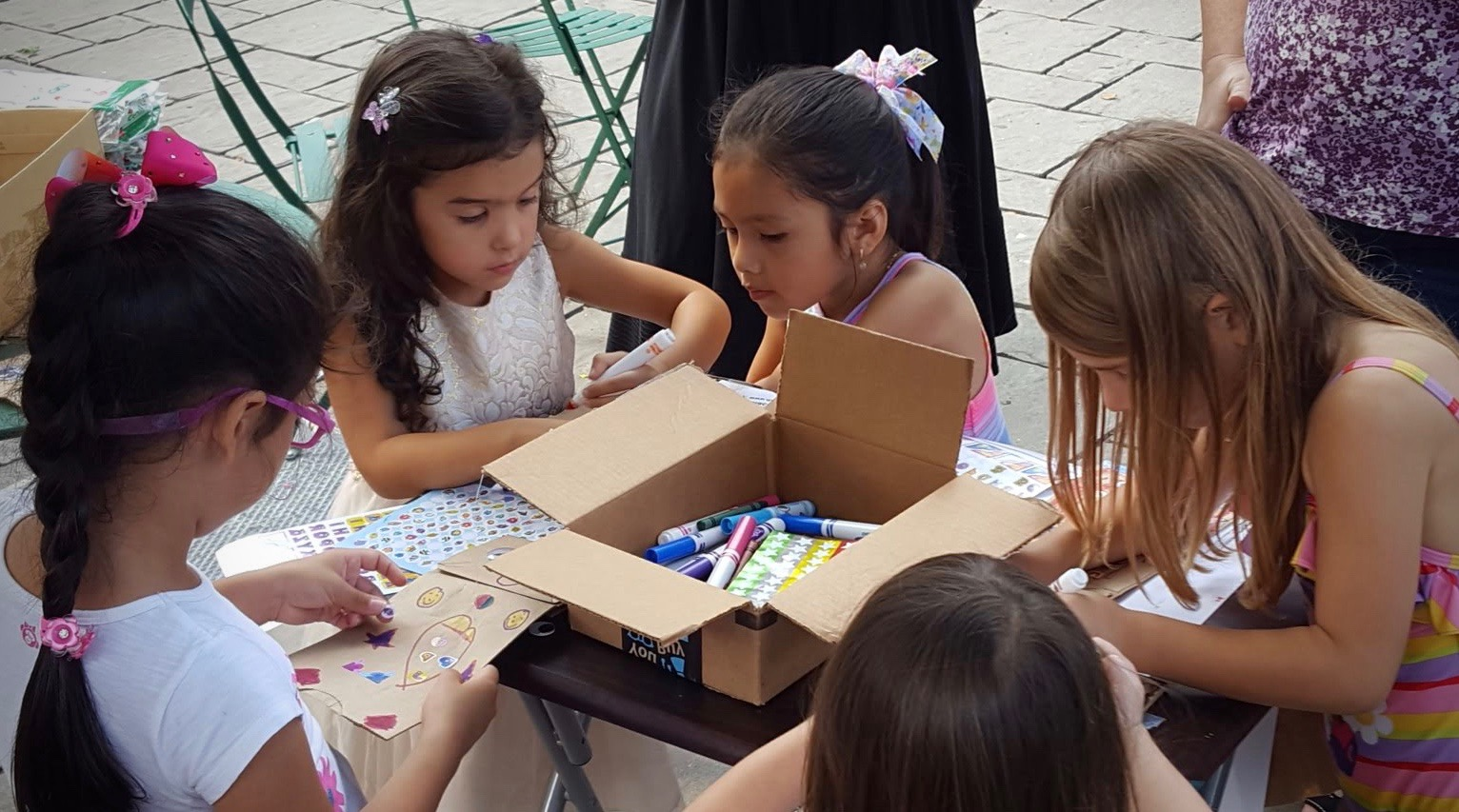 Kids make paper puppets with Firefly at the Viva la Comida street festival sponsored by the 82nd Street Partnership! September 2018.