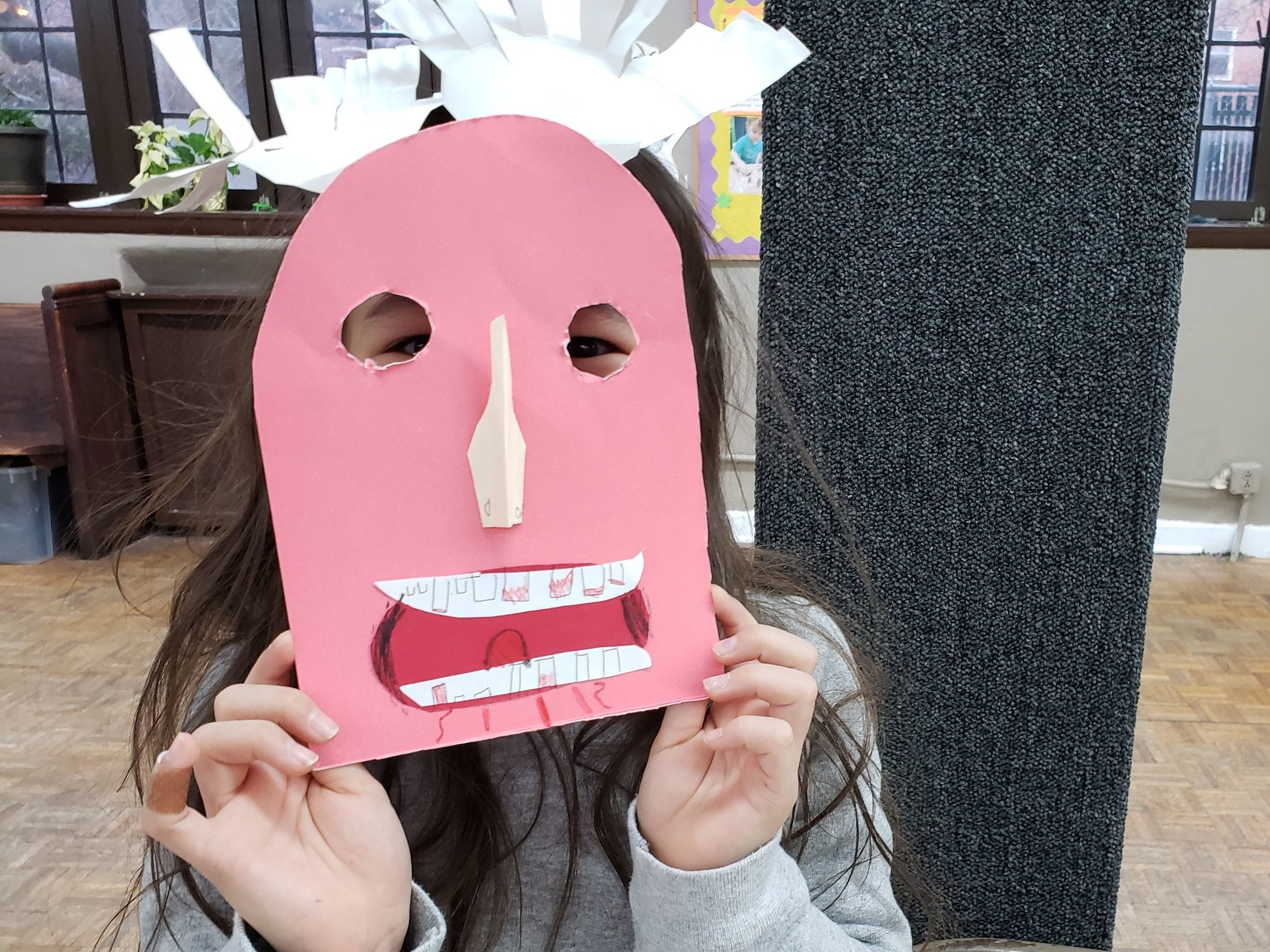 Kids made masks and shadow puppets at our craft party! January 2019.