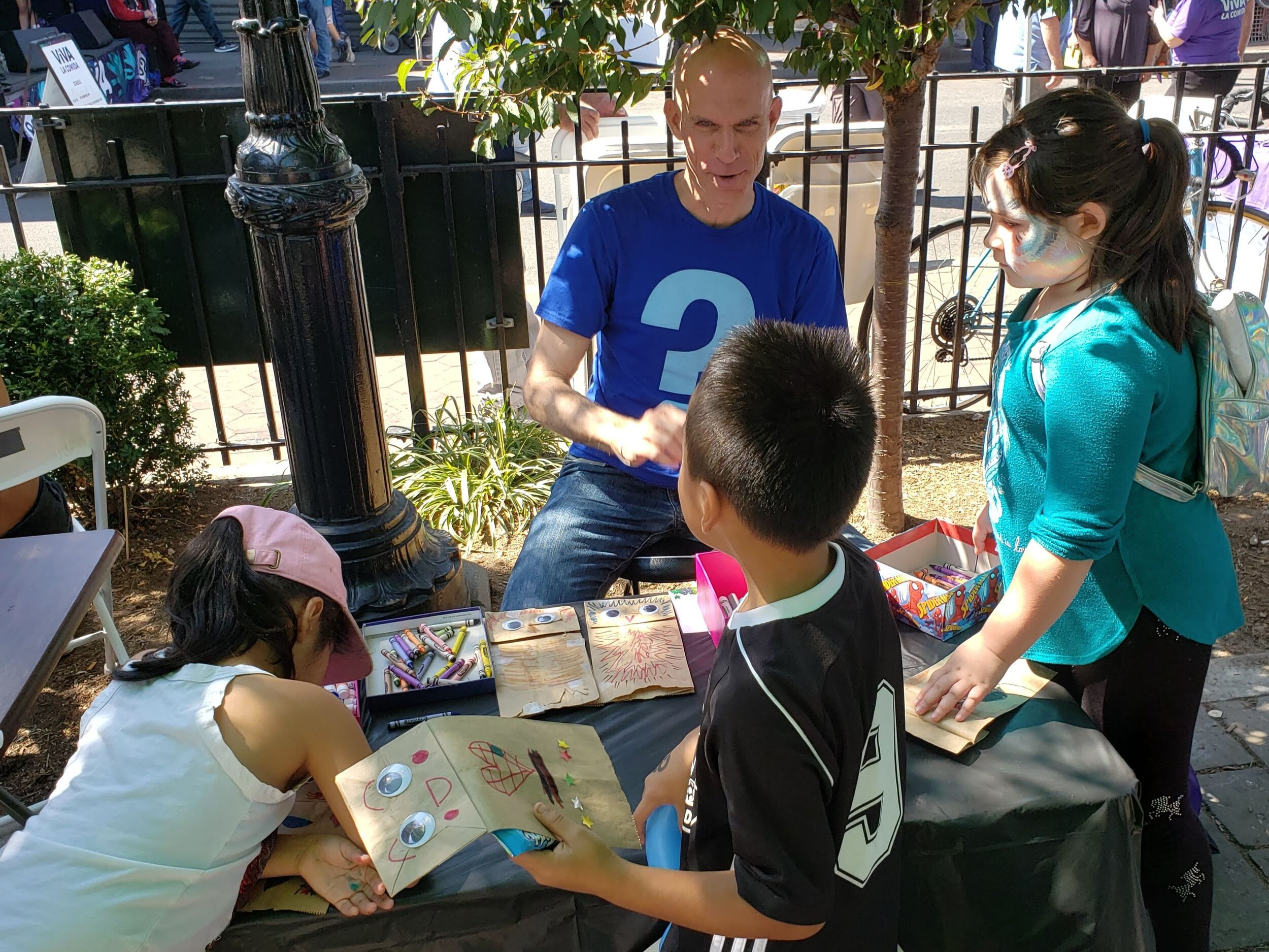 "Puppet-making table at the ""Viva la Comida"" street fair organized by the 82nd Street Partnership. September 21, 2019."