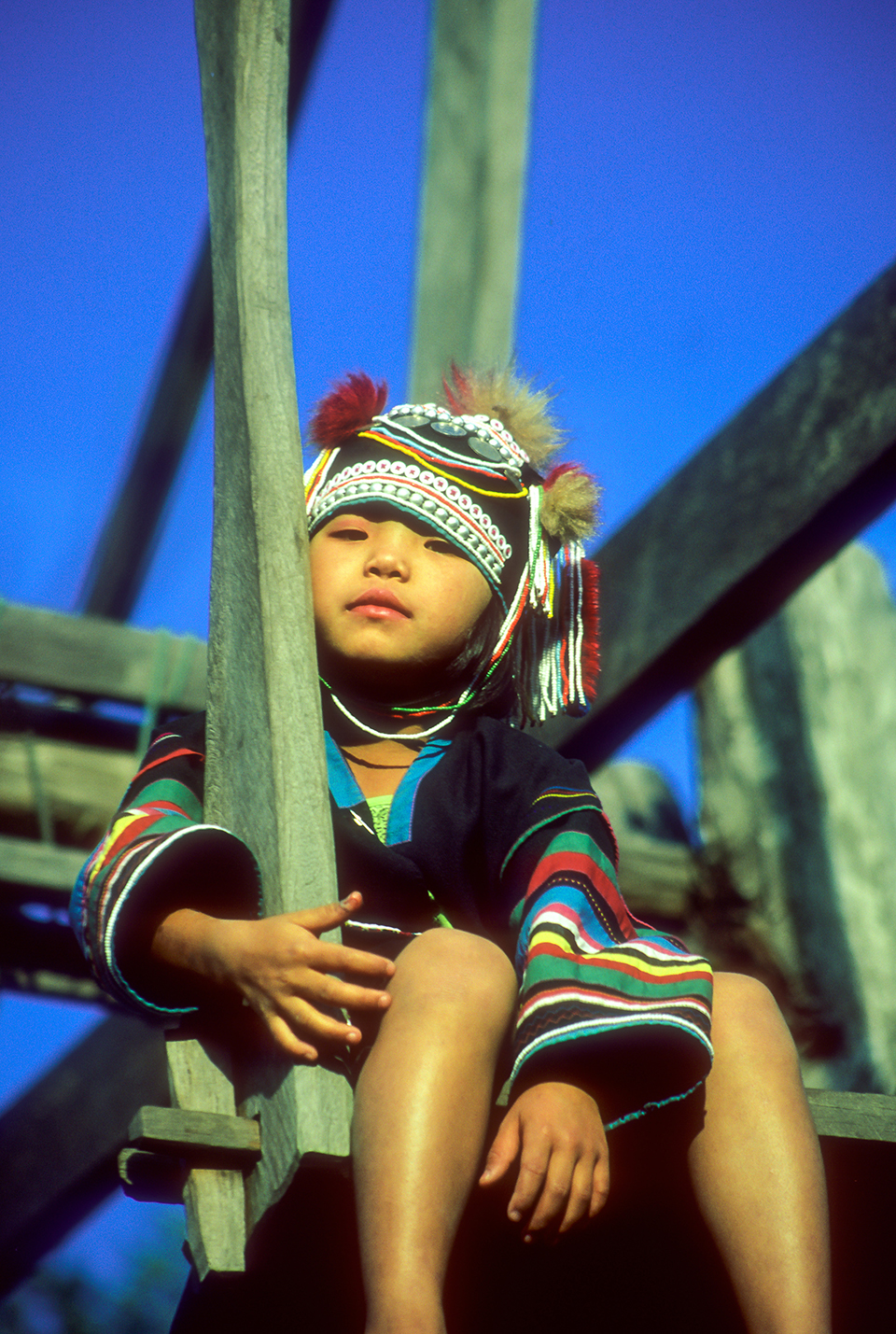 Young Akha girl on swing in Northern Thailand, Thailand. 1998 PS.jpg