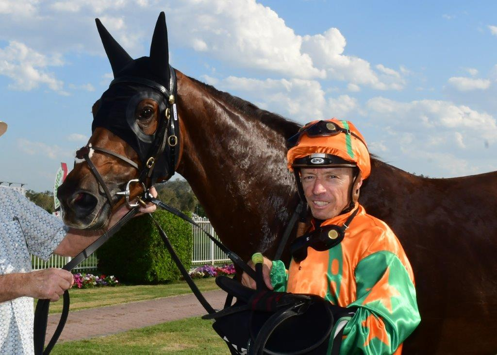Image courtesy Trackside photography - Michael Cahill unsaddles Akage after an Ipswich win.