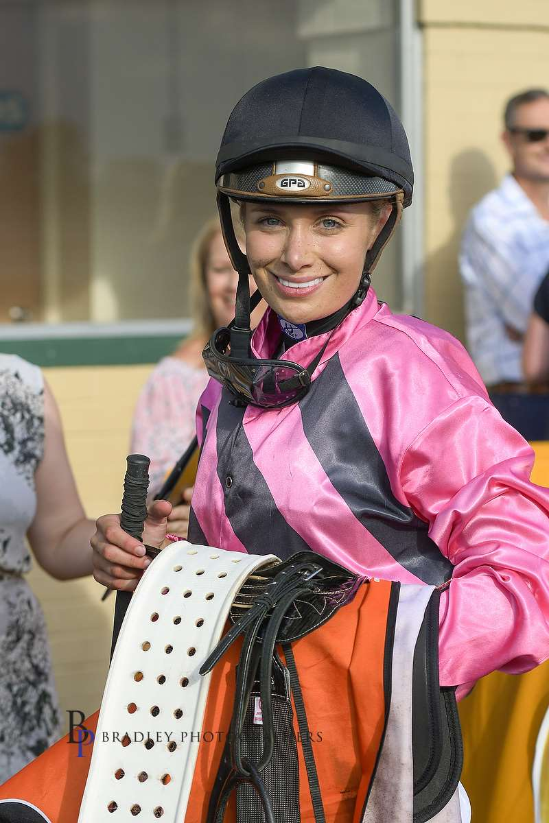 Image courtesy Bradley Photographers - Claire is all smiles after winning on the Wade Slinkard trained Stradazzle at Hawkesbury.