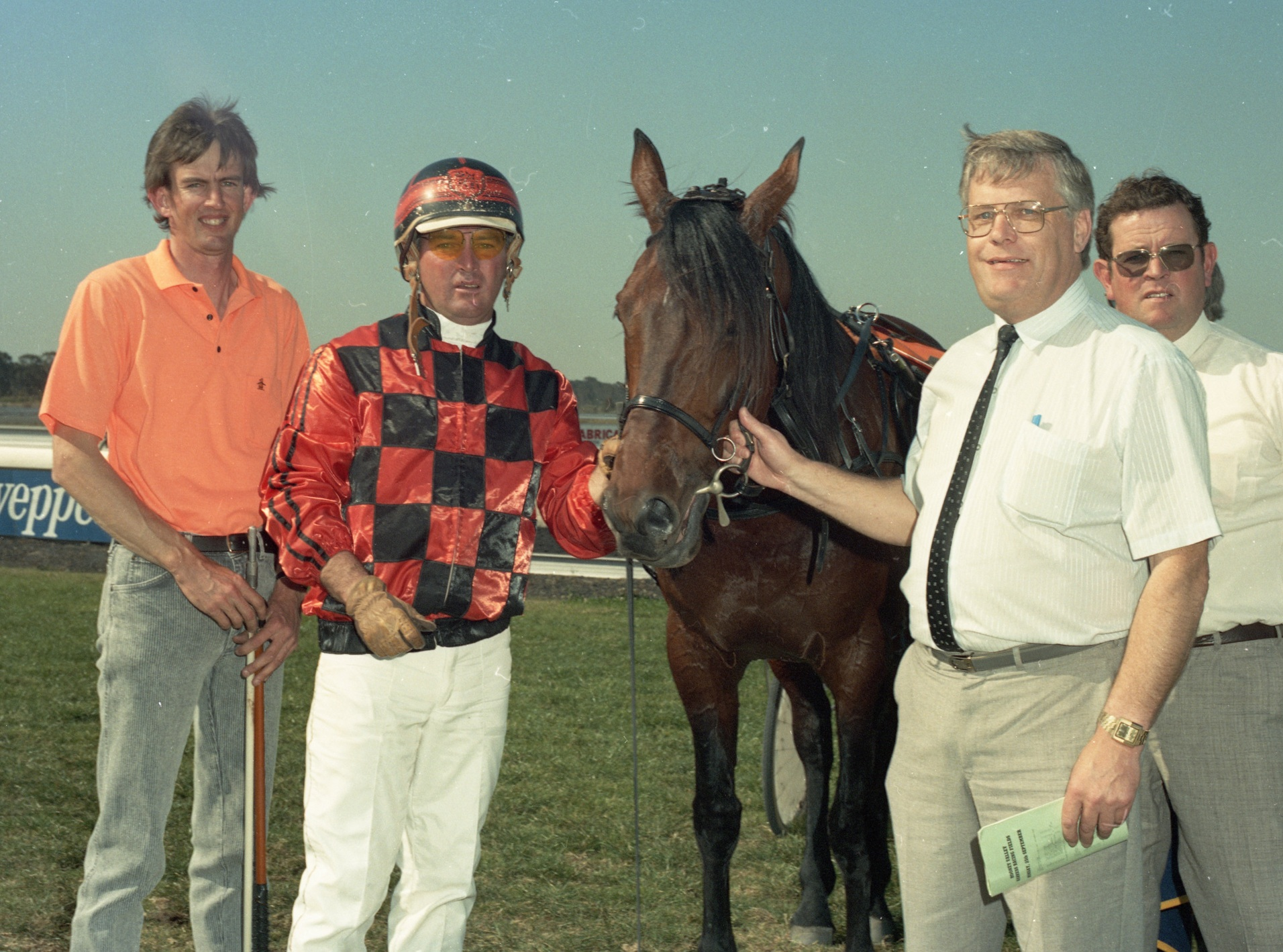 Image courtesy National Trotguide - Howard with his mentor, Brian Hancock, Wyong 1989.