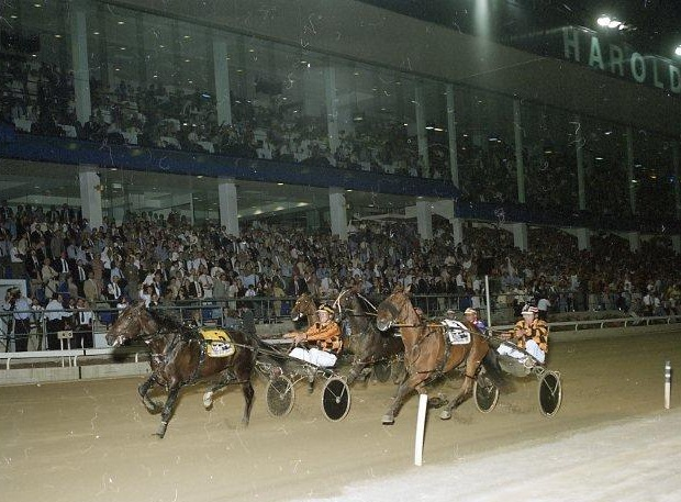 Image courtesy National Trotguide - With Brian Hancock under suspension, Howard snared the winning drive on Our Sir Vancelot 1997 Miracle Mile.