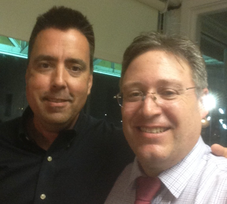 Fred got to call three races at Yonkers during a holiday trip. Here he is in the box with USA caller John Hernan.