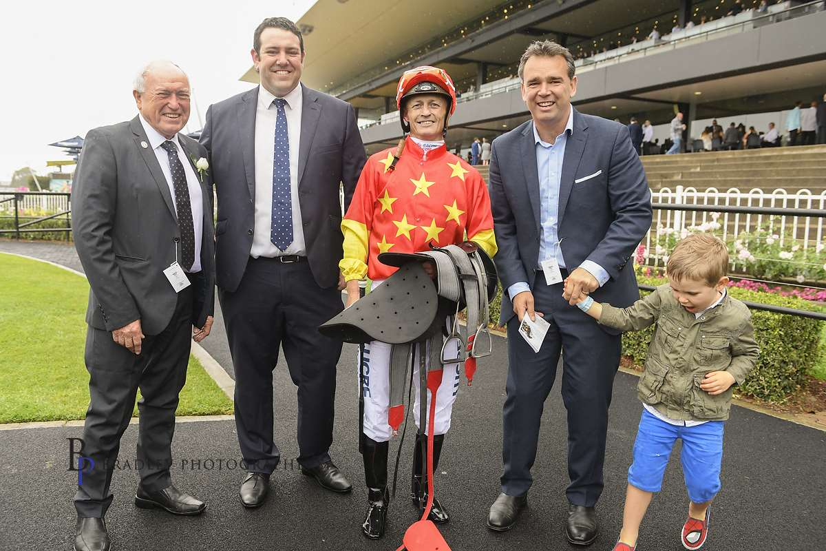 Image courtesy Bradley Photographers - A group of satisfied customers with Damian Browne at Rosehill.