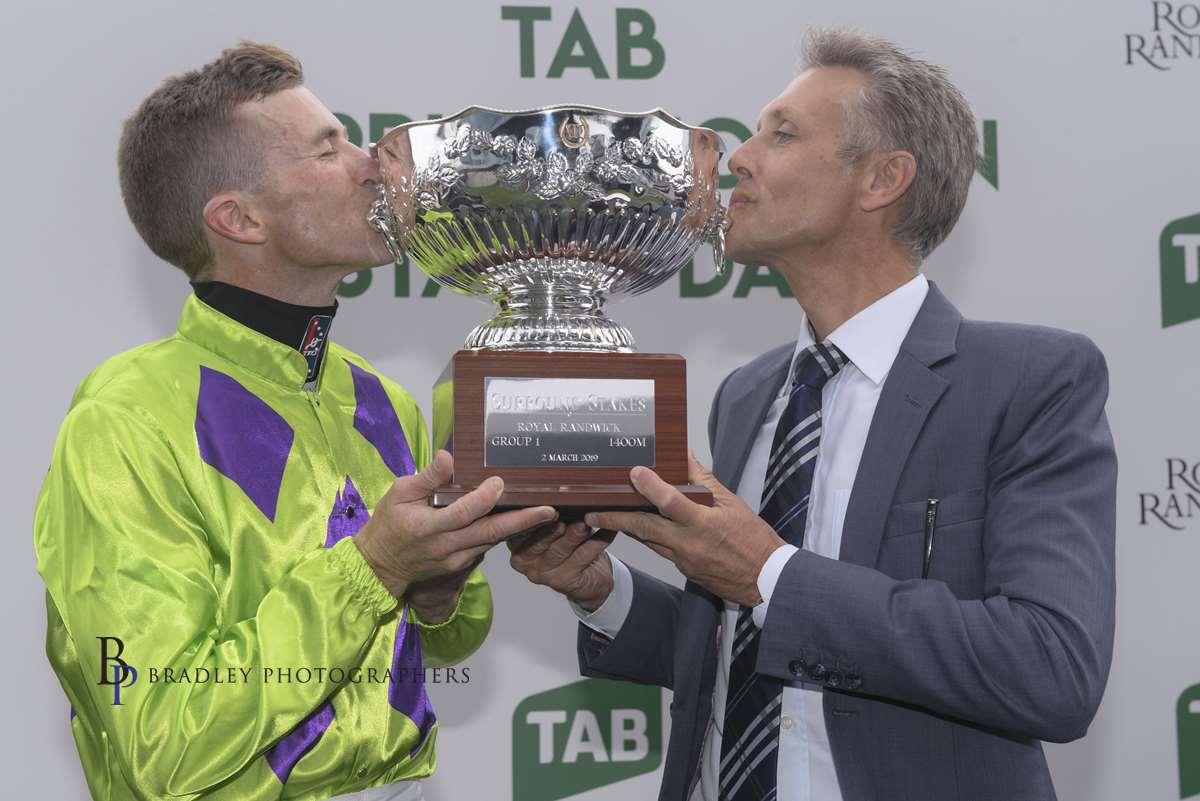 Image courtesy Bradley Photographers - How sweet it is! Mark and Josh Parr celebrate a Group 1 Surround Stakes win with Nakeeta Jane.