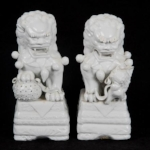 PAIR OF CHINESE BLANC DE CHINE FOO DOGS